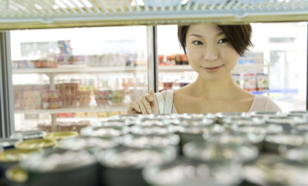 Woman choosing drink at convenience store