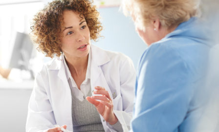 An image of a pharmacist demonstrated a patient-centric approach in pharma with a patient