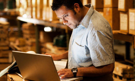 Image of a wholesale distribution employee using a system needing an ERP upgrade
