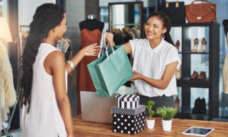 Women picking up from store in omnichannel retail environment