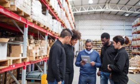 Team using a supply chain digital twin to improve logistics